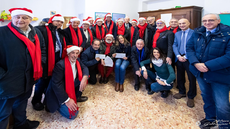 Consegna assegni di Natale dalla Compagnia di Babbo Natale